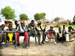 [Sudan] Boys and young men from the White Army civilian defence force in Akobo, Jonglei State, South Sudan, July 2006. Some members of the White Army have resisted disarmament for fear of increased vulnerability to attack. Others do not accept the authori