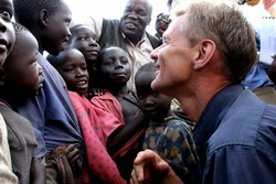 Jan Egeland, Under-Secretary-General of the United Nations and Emergency Relief Coordinator, talks to children in Opit camp for internally displaced people, Gulu district, northern Uganda, 9 September 2006. Egeland visited northern Uganda to assess the si
