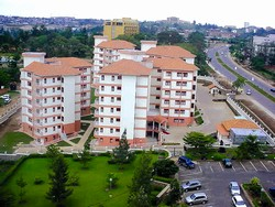 [Rwanda] Run down areas in Kigali are giving way to offices and apartments such this in the city centre. [Date picture taken: 07/14/2006]