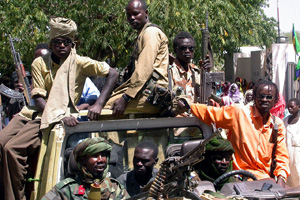 [Sudan] Armed men from the Sudan Liberation Movement Army (SLM/A) in Gereida town, south Darfur, Sudan, 24 February 2006. Despite a May peace deal, the UN says violence and displacement have increased in the region.