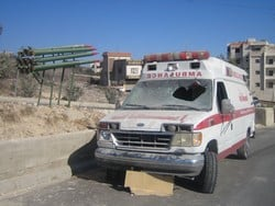 [Lebanon] A wrecked Red Cross ambulance lies on the road side in Bint Jbeil. [Date picture taken: 08/31/2006]