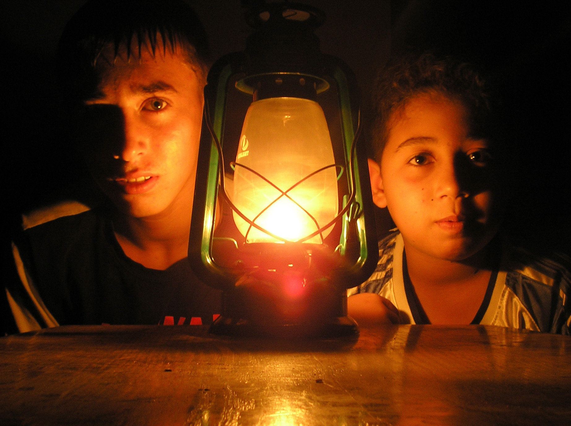Ahmed, 14, and Amjad, 12, during a power cut in Tal Zaatar, Gaza