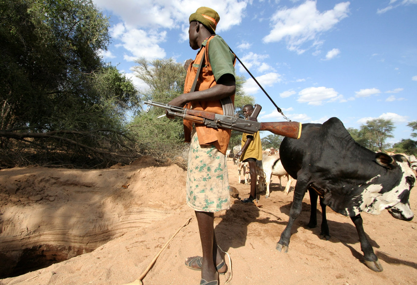 A young Turkana man armed with an AK-47 rifle, Oropoi, northwestern Kenya, 18 February 2007. Conflicts involving pastoralists associated with resource competition, cattle rustling and arms are widespread and of increasing concern in the region.