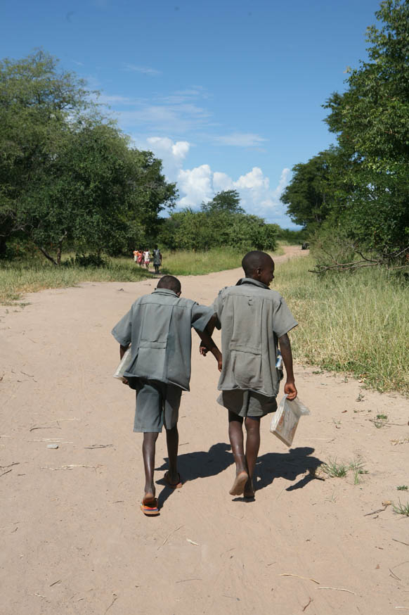 Two boys go back home at the end of their school day, Ngoma School, Sikaneka village, Maamba district, Zambia, 28 February 2007. The UN's Millennium Development Goals for 2015 aim to improve primary education, reduce child mortality, promote gender equa