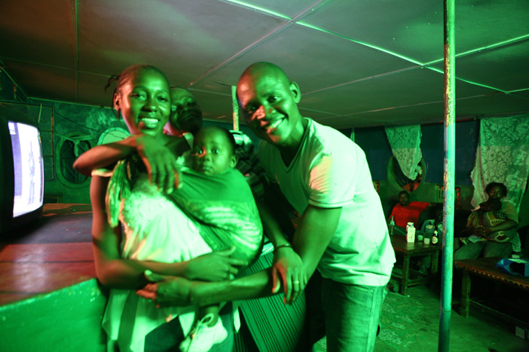 A young prostitute holding her child poses next to a client in a bar, 26 March 2007. Alcohol and drug use can lower inhibitions, increasing the risk of HIV infection. However, some groups are especially vulnerable - most notably young women. The impact of