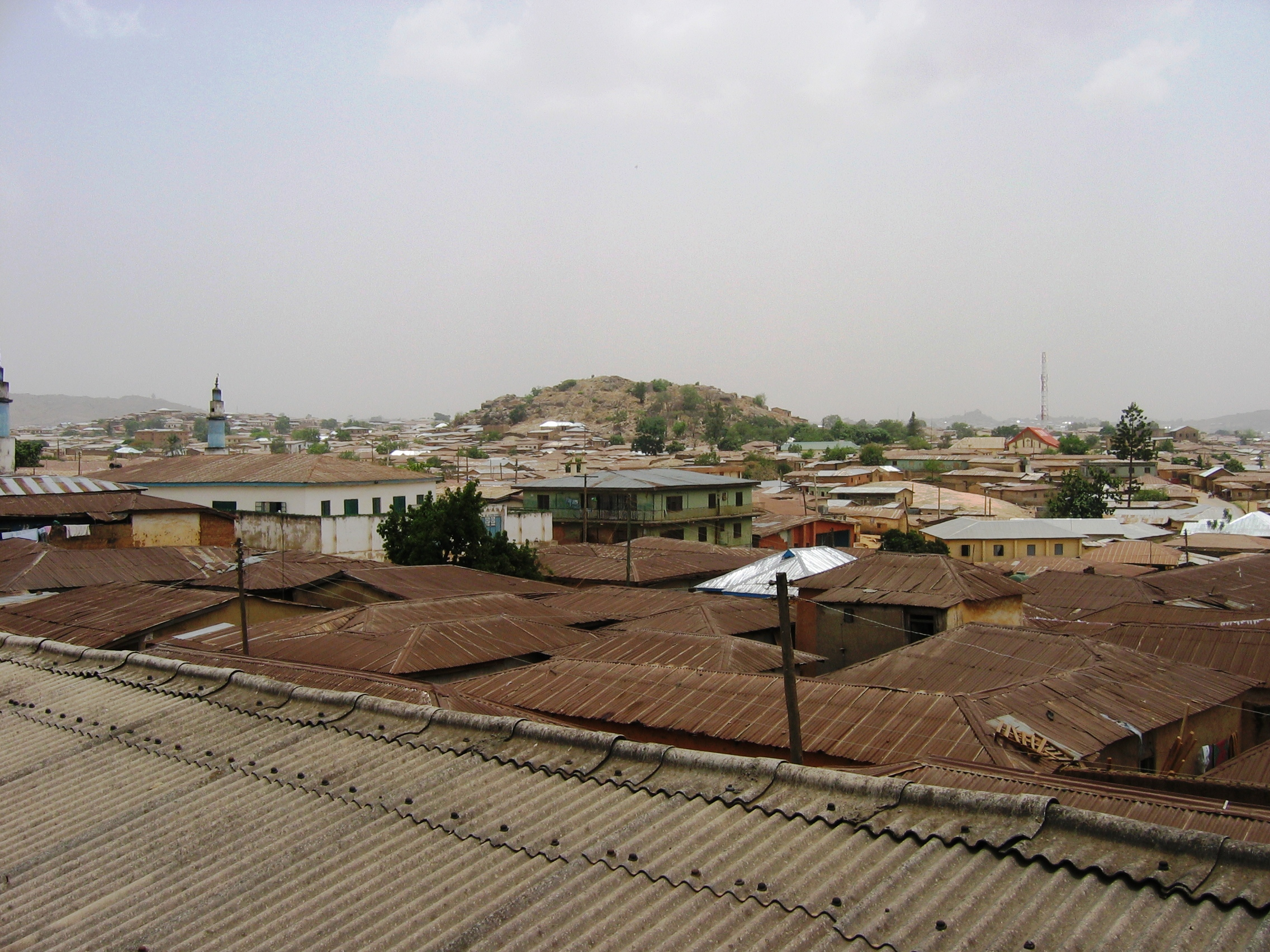 The mosque with the blue minaret (left) in Jos's dense Congo Russia neighbourhood is now the landmark for the explosion of religious tensions in 2001, Nigeria, 4 April 2007. The trigger for the flare-up was a wrangle between Christians and Muslims after a