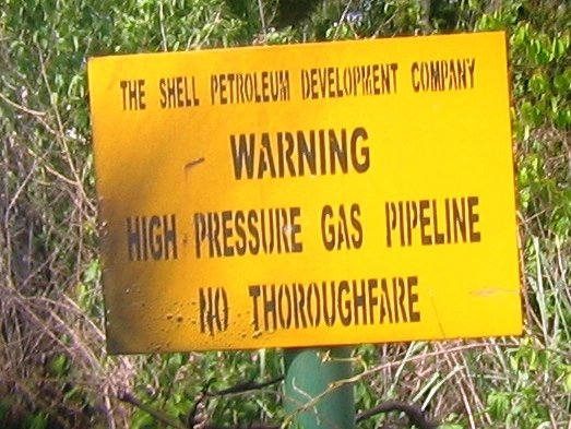 Oil company sign near Port Harcourt in the Niger Delta region.