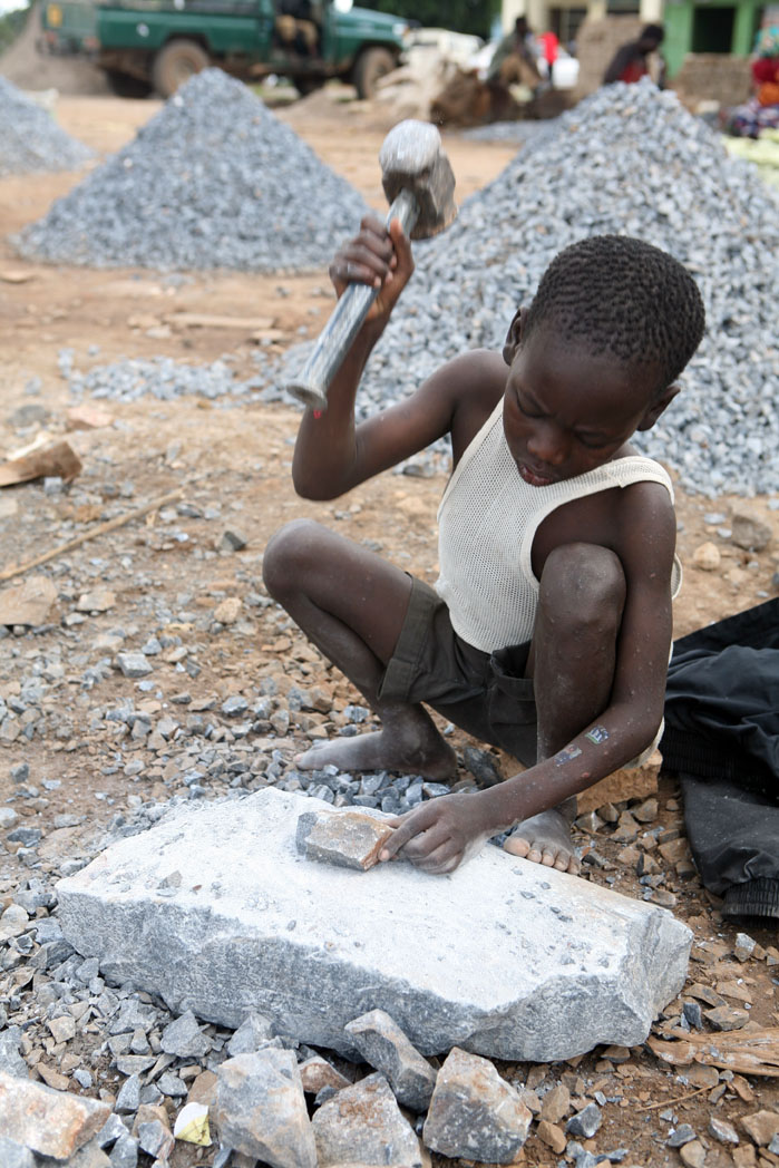 A young boy breaks stones at a quarry, Zambia, 7 March 2007. Child workers can get jobs as street vendors, quarry workers, water carriers, porters (kuzezera), domestics, well and refuse- tip diggers, carpenters, market cooks, grass-cutters, bottle collect