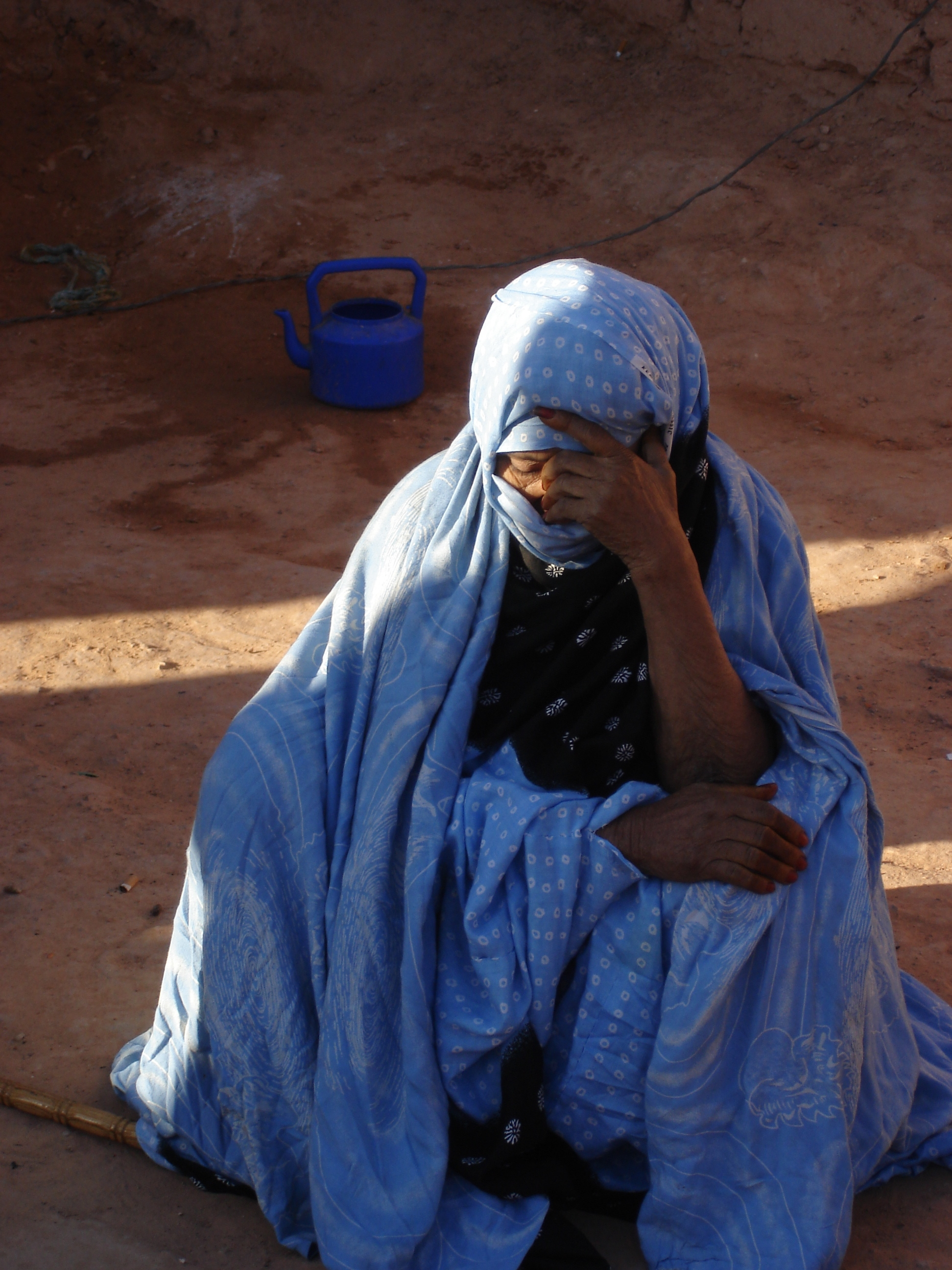 A Sahrawi refugee, divided from her family by the dispute, Western Sahara, April 2007. The Sahrawi people are divided by minefields, army outposts and a manmade wall of sand more than 2,400 km long. There has been a long-standing dispute that pits the Mor