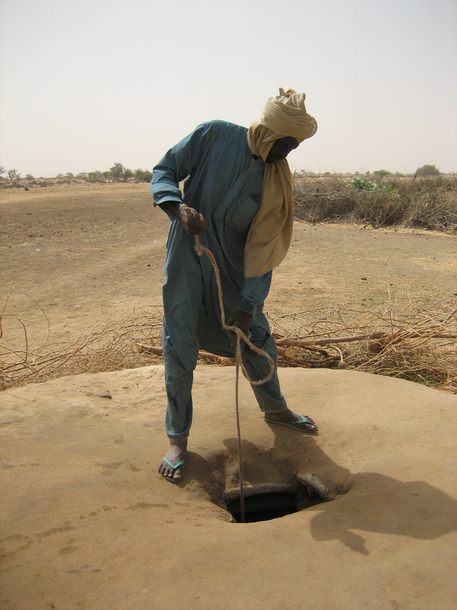 A man using a basic, traditional well in the Tahoua region of central Niger. Some 60 percent of Nigeriens do not have regular access to clean, modern water sources.
