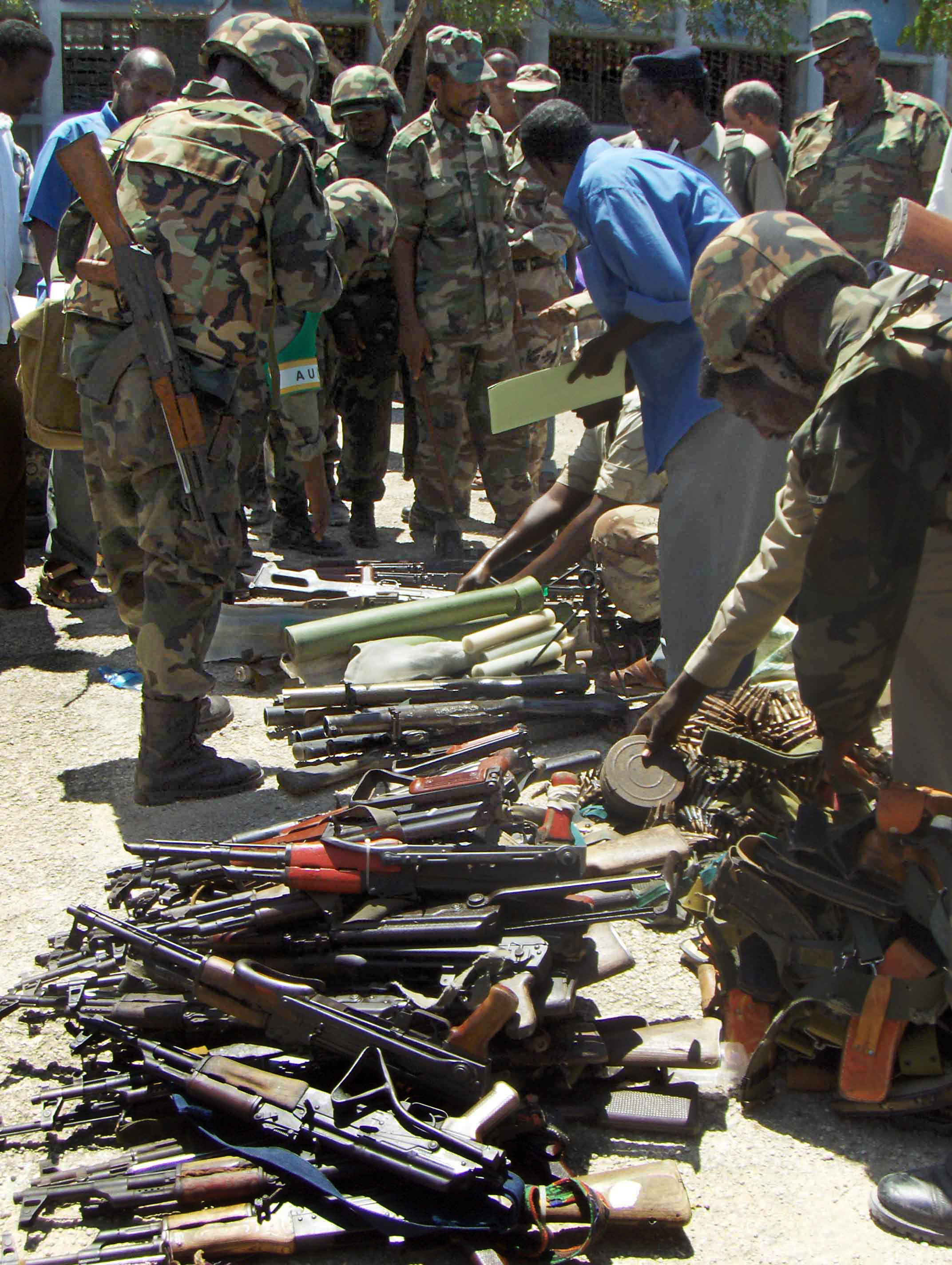Ugandan AU peacekeepers checking through weapons handed in by Somali businessmen, 3 May 2007. Hawiye clan leaders and government officials said the surrender was the result of several days of negotiations that may have been helped by the naming of two Haw