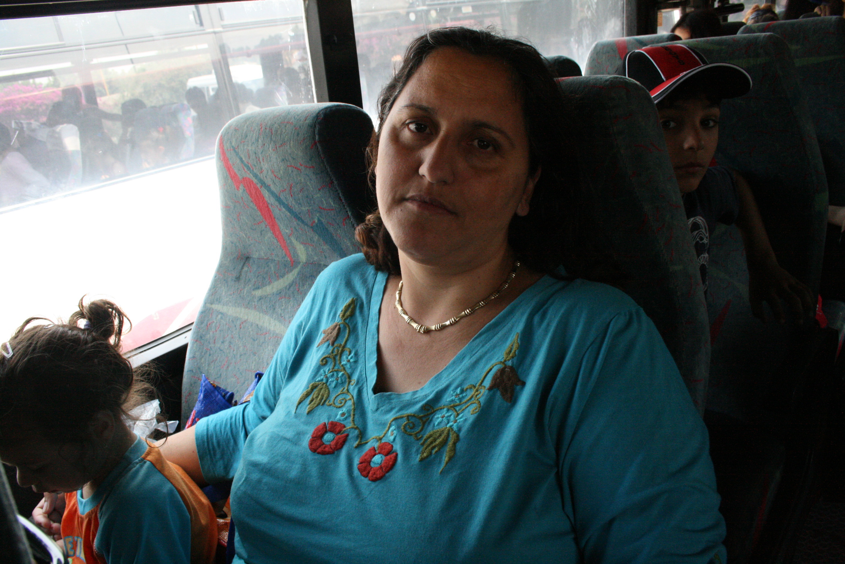 Yael Levi on a bus with her children Sderot, OPT/Israel, May 2007. She says she would like to leave Sderot, the target of rocket attacks from the Gaza Strip, for the sake of her children.