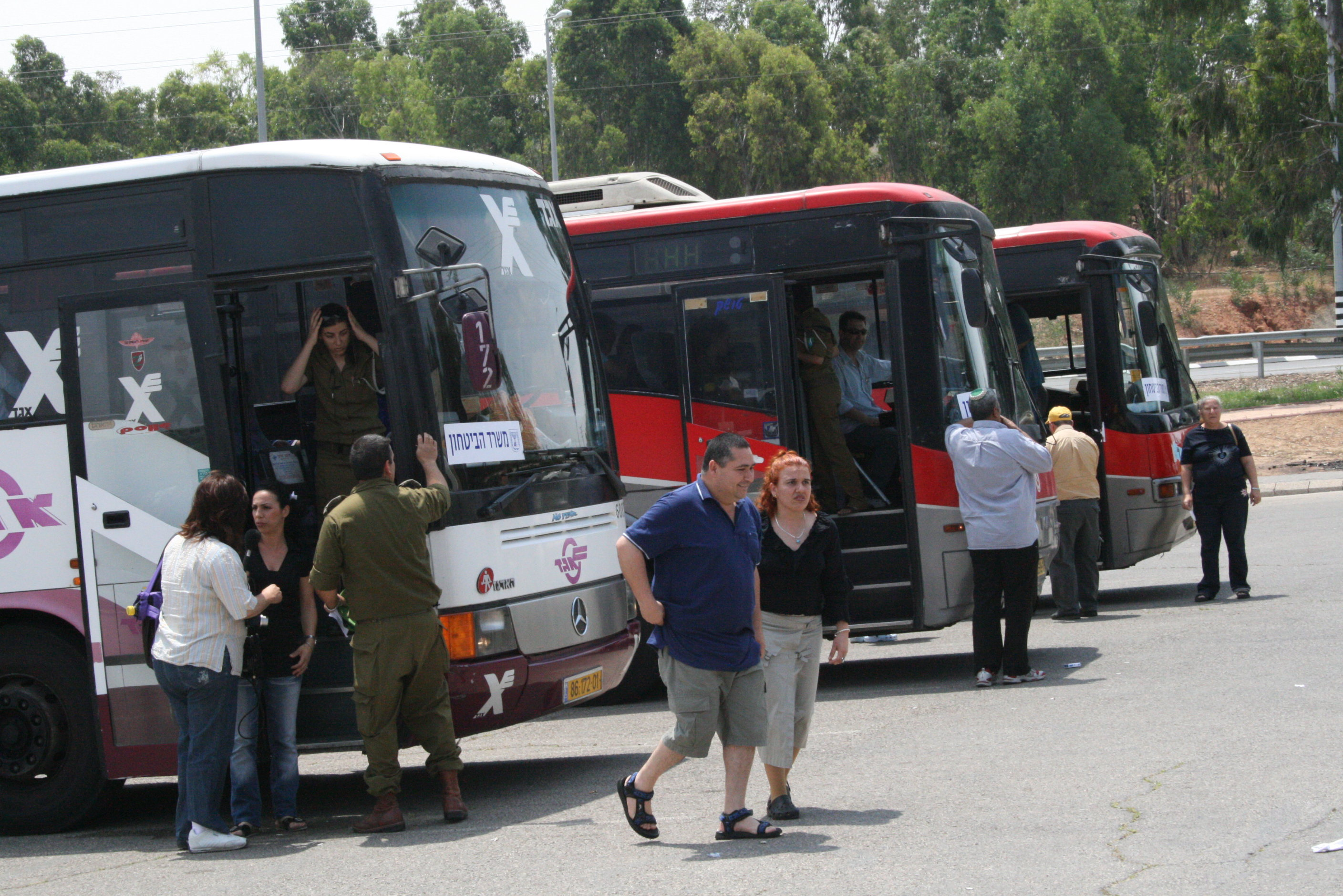 Buses organised by Israel's Ministry of Defence to evacuate residents from Sderot, scene of intense rocket fire from the Gaza Strip ,Sderot, OPT/ Israel, May 2007.