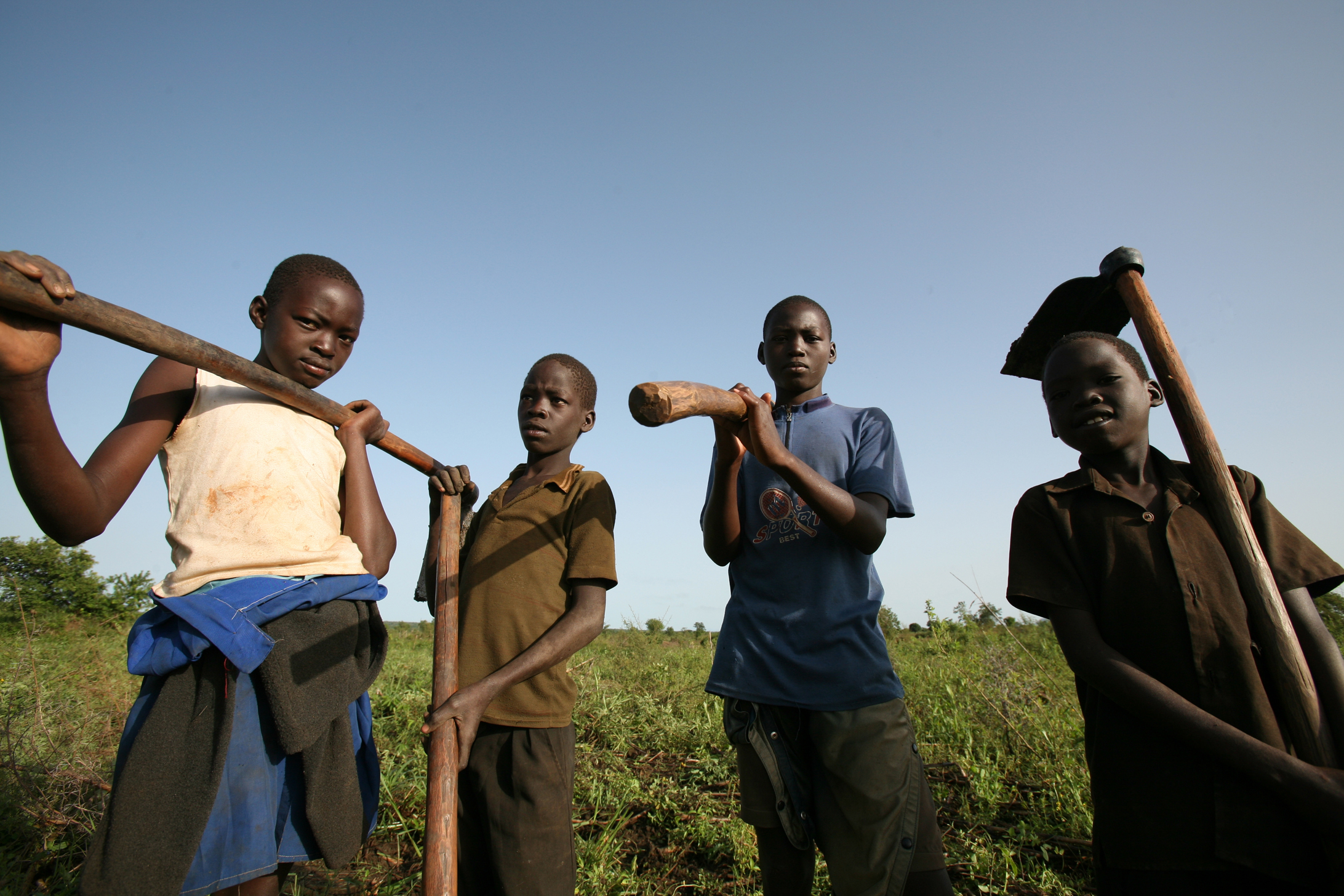 Young boys prepare land for cultivation near Oromi IDP camp, Kitgum District, northern Uganda, 19 May 2007. In the north, particularly in Gulu and Kitgum Districts, 12 years of violence by the rebel LRA has forced over 200,000 people from their homes. A f
