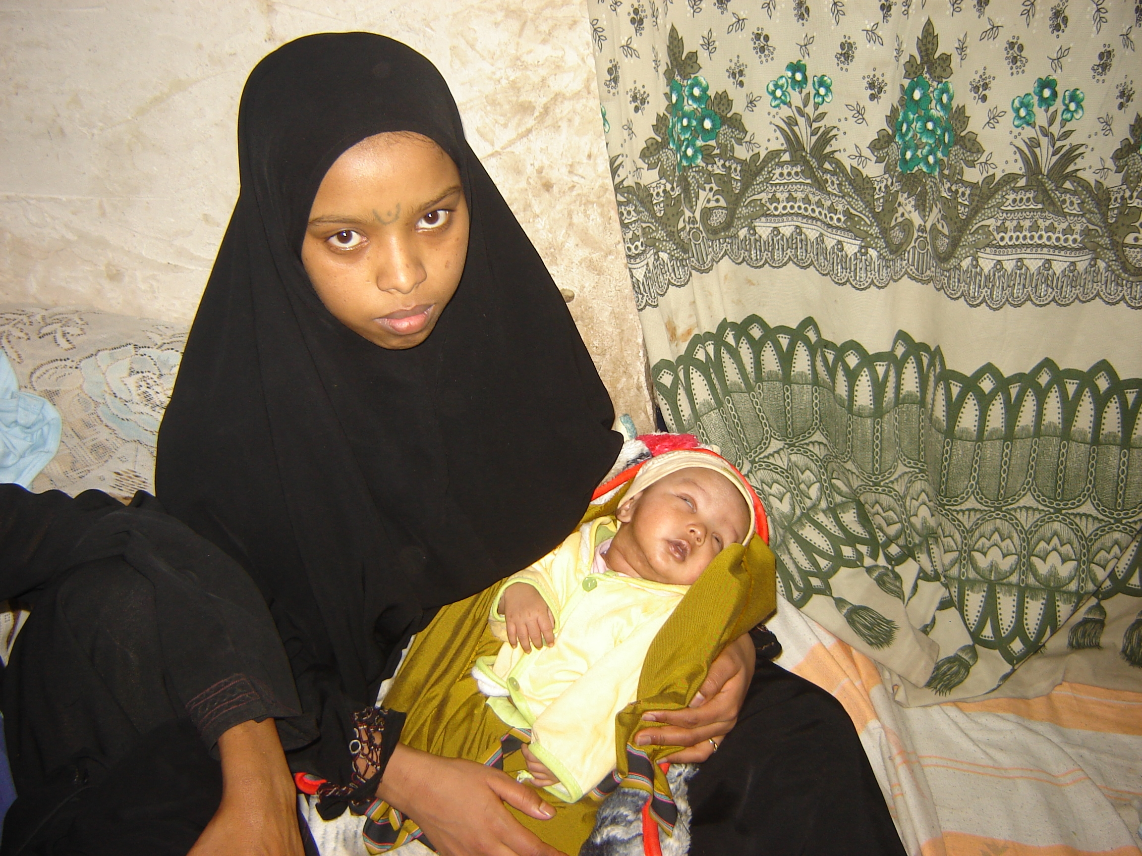 An Oromo woman with her baby