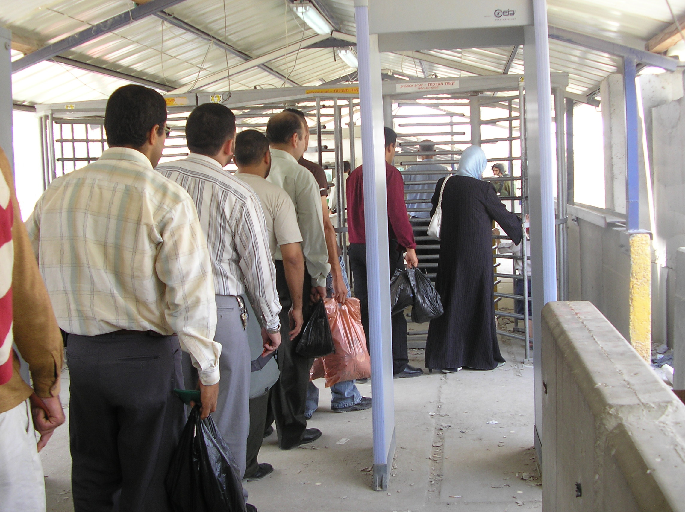 Palestinians queue at Beit Iba checkpoint north of Nablus.
