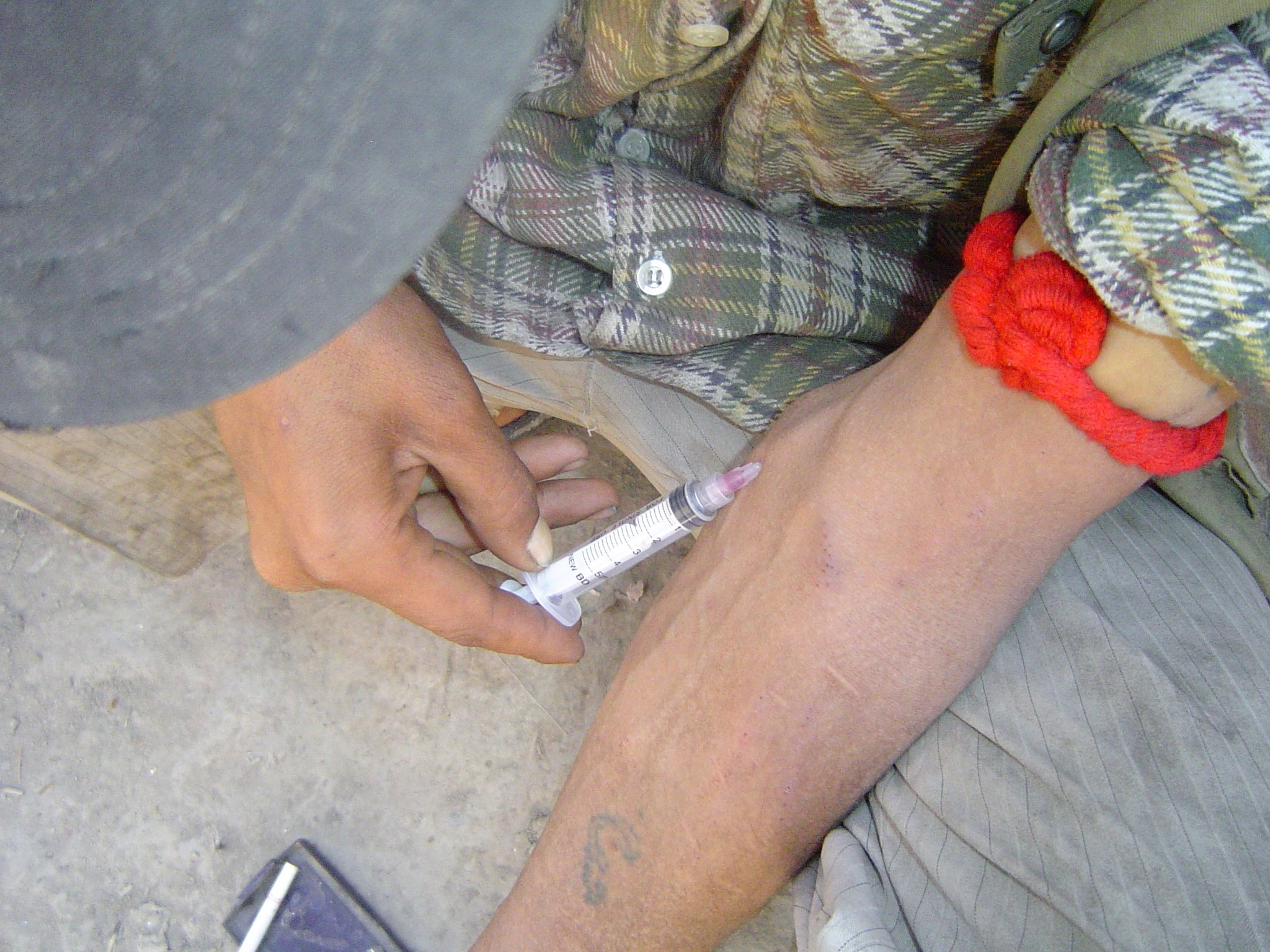 An Afghan man injects heroin in Kabul.