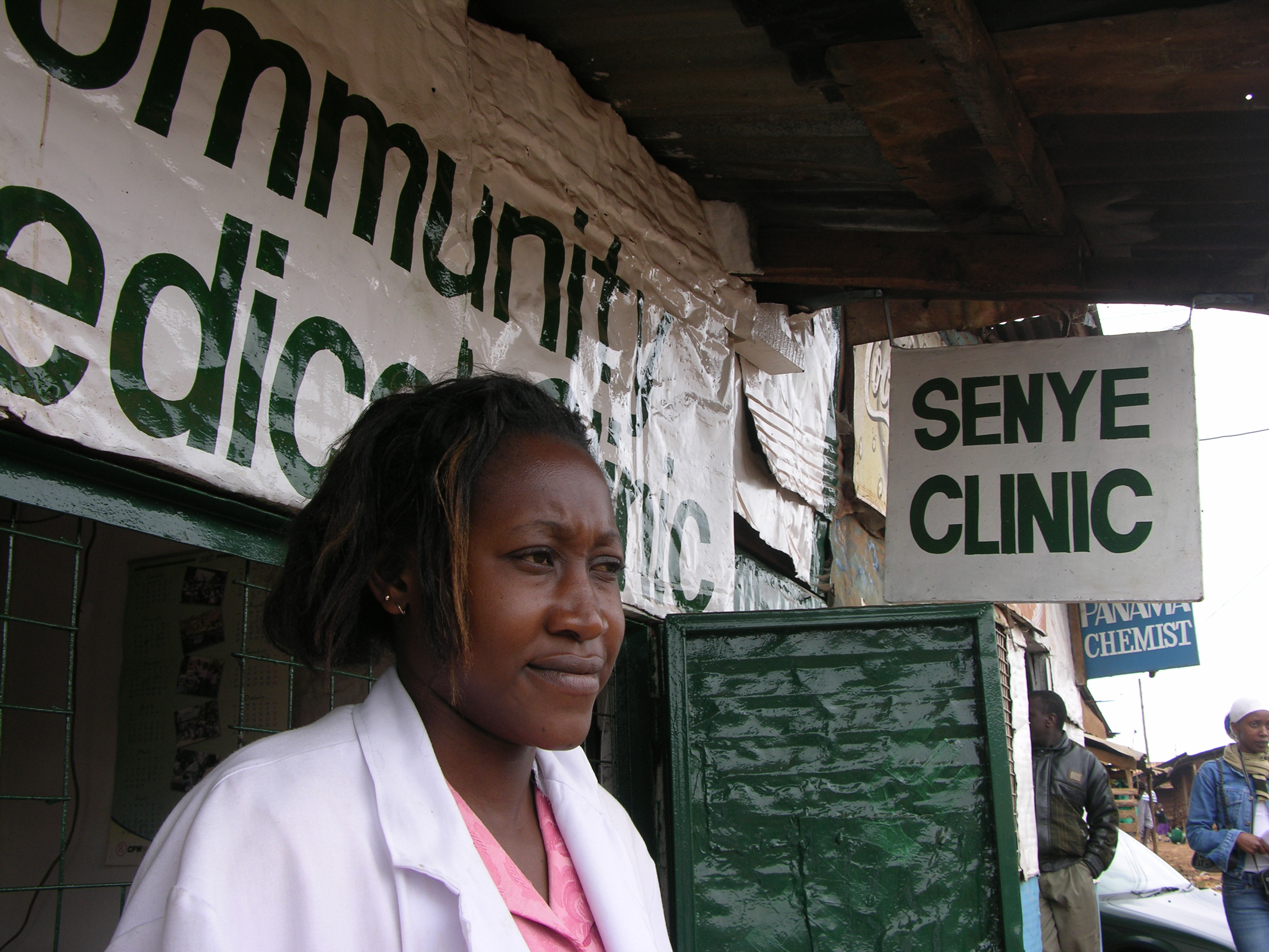 Nurse and entrepreneur Dorah Nyanja outside the health clinic she owns and operates in Nairobi's Kibera slum, Kenya, 2007.