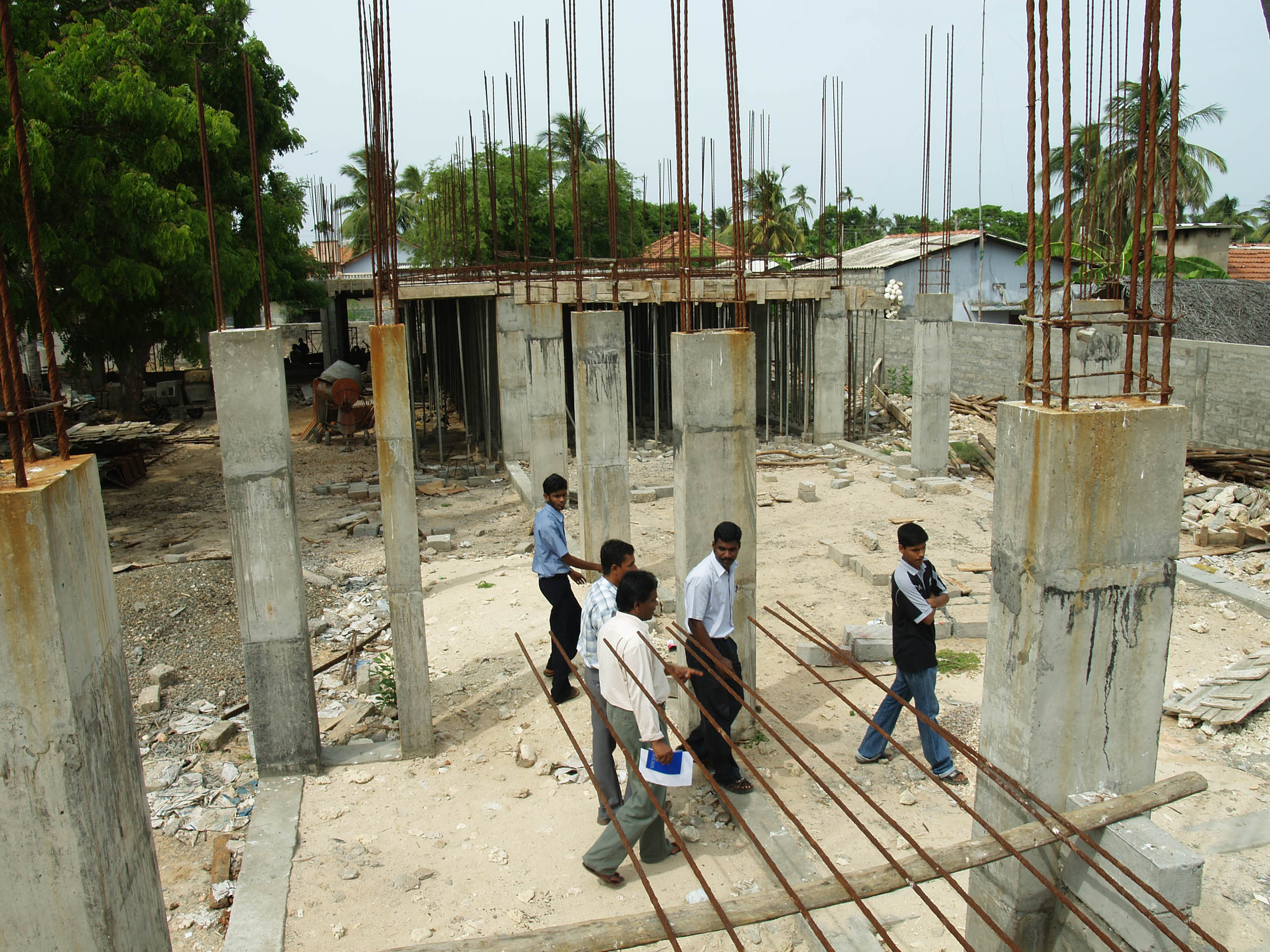 UNICEF and UNOPS staff tour the construction site for the Valvai Sivaguru Vid school in Point Pedro, Jaffna District.  UNICEF is financing and UNOPS is building the school and one other in the area.  Construction has faced many delays due to the security