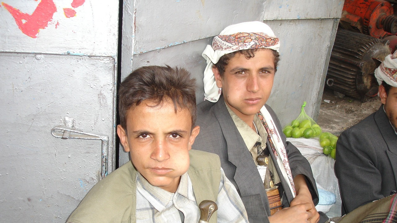 Two boys enjoy a qat chewing session on the streets of the Yemeni capital, Sana'a. Upwards of 85 percent of all adults in the country chew the leaves, despite serious health implications.