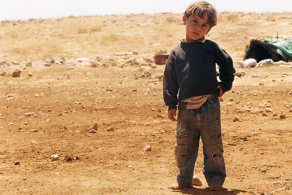 A boy in al-Hadidiya, near his family's tent.