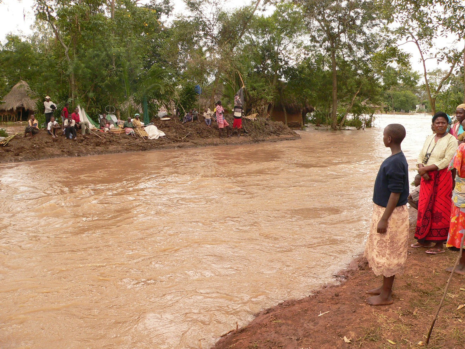 Budalangi residents are stranded as floods tear through their village in Busia. More than 40,000 people have been displaced after a dyke was washed away at Makunda, River Nzoia, Kenya, August 16, 2007.