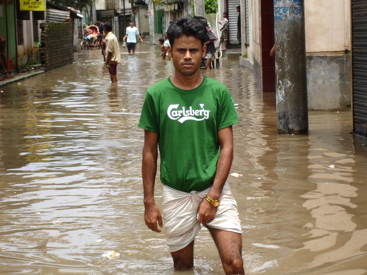 A flood-affected street in Kalachadpur, Dhaka, the Bangladeshi capital. Each year large portions of the city are flooded during the annual monsoon.