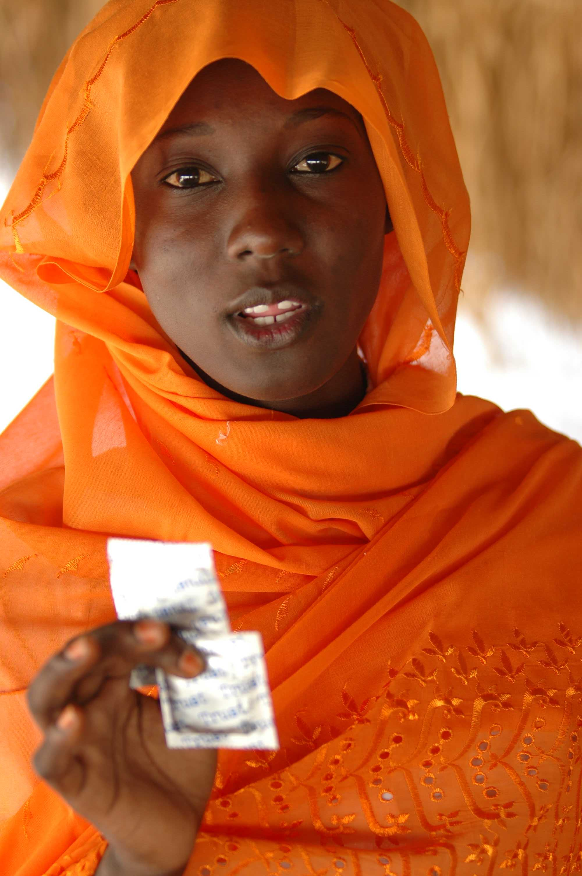 A Muslim woman working with GOAL teaches healthcare and use of condoms in Sudan, May 2006. GOAL is an international humanitarian organisation.