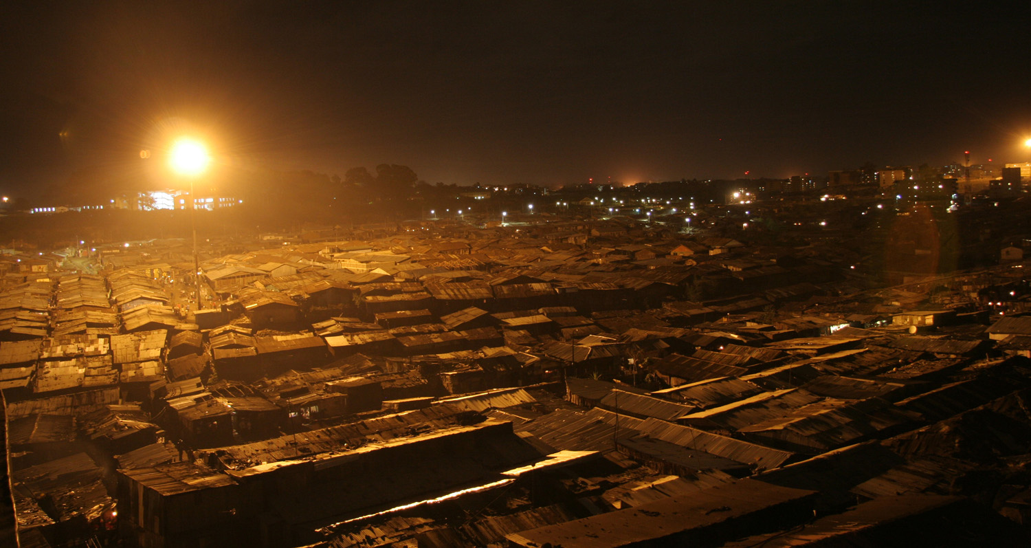 A night view of Mathare slum, Nairobi, Kenya, September 2007. It is one of the biggest slums in Africa and home to more than 700,000 people, most of whom depend on small businesses, such as selling fresh produce, labouring and brewing illicit alcohol, to