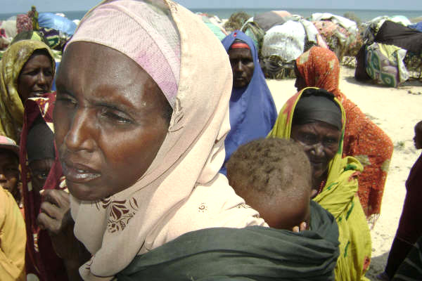 Nadifo Gedi, carrying her baby, an IDP on the northern outskirts of Mogadishu. September 2007.