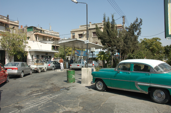 Cars queue at a petrol station in Damascus, where from next year fuel prices are set to soar as the government begins phasing out unsustainable subsidies.