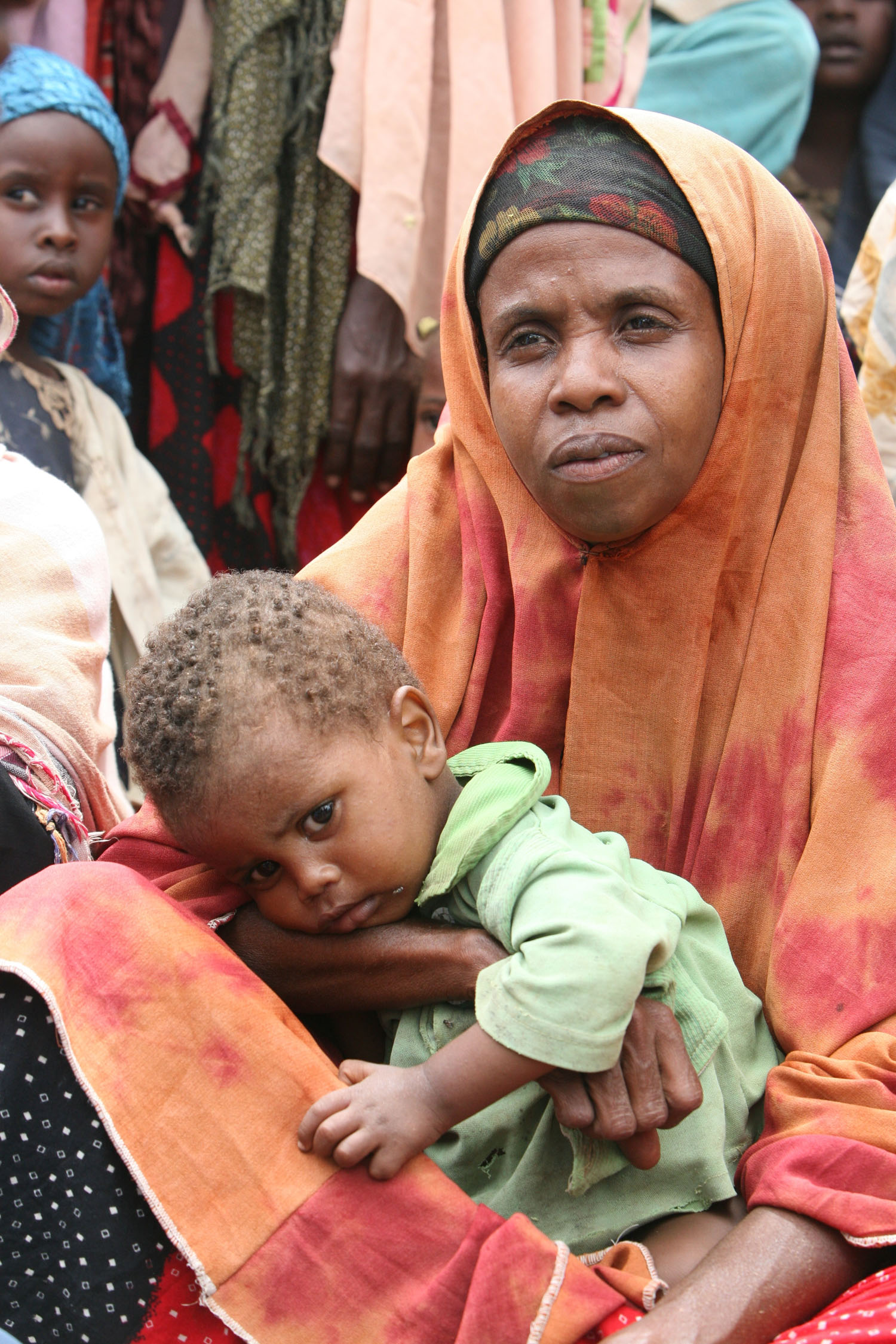 A mother and son wait for food in Jowhar, Somalia, September 2007. Tens of thousands of Somalis who fled the violence in the capital are facing yet another humanitarian crisis, a debilitating food shortage after poor rains.