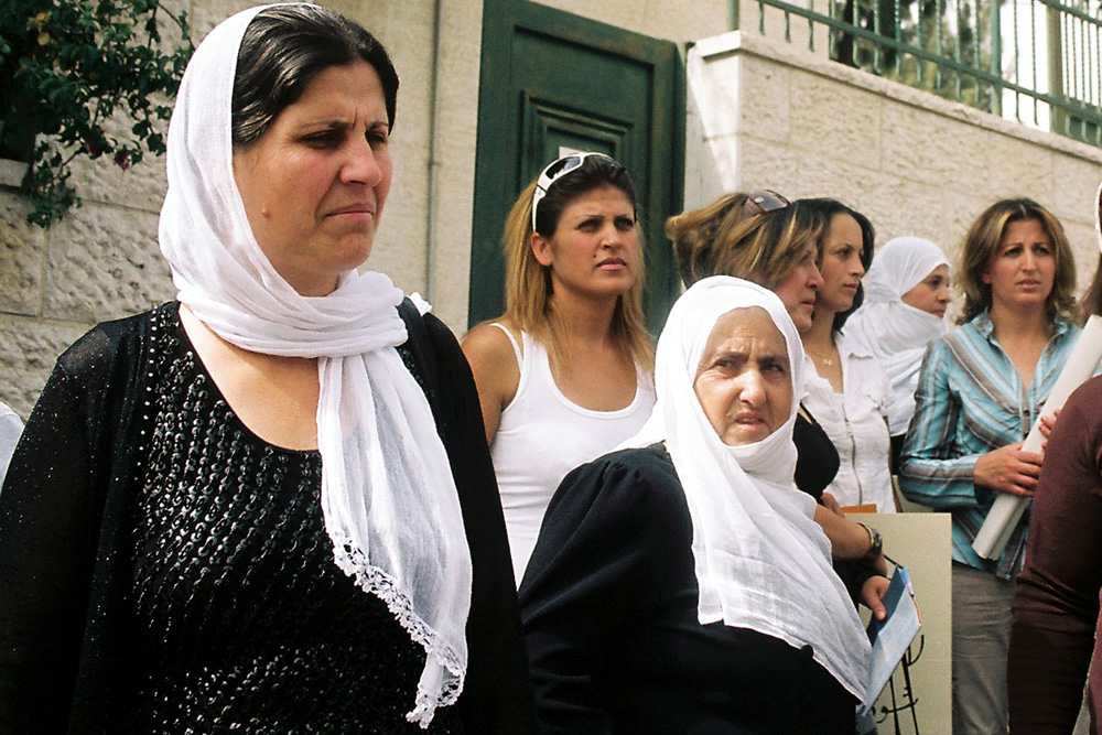 Druze women who are disconnected from their families in Syria protest outside the ICRC building in East Jerusalem.