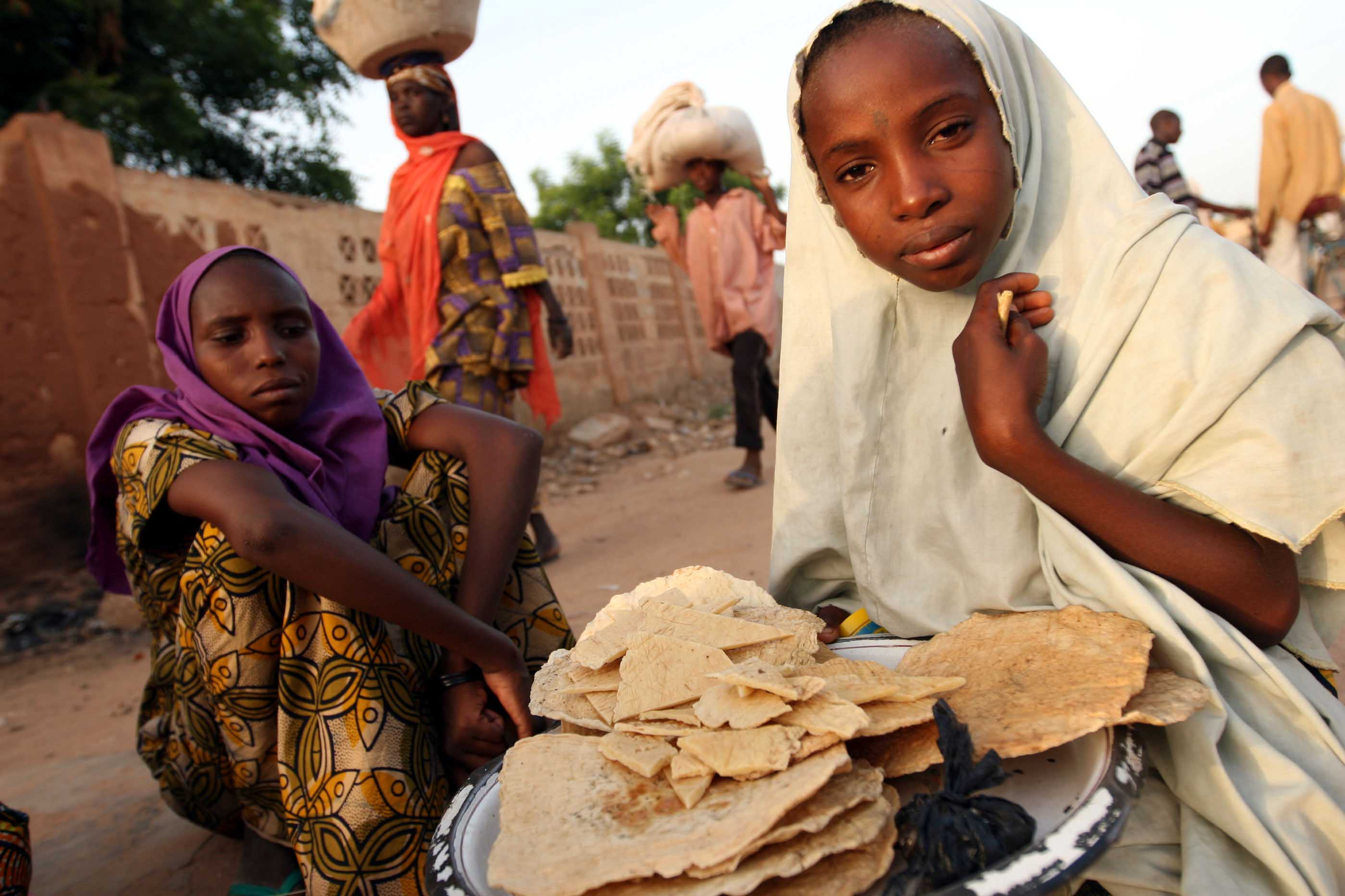 A girl sells locally made cheese in Zinder, Southern Niger on 16 September 2007.