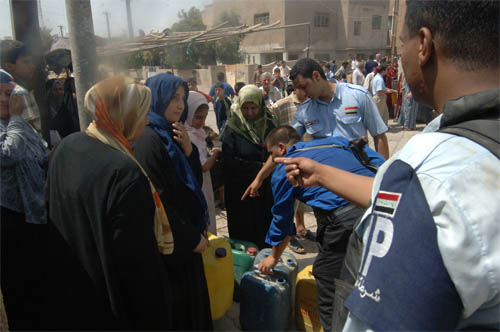The Iraqi government says because of a drop in sectarian violence in the country, thousands of displaced people are returning home.