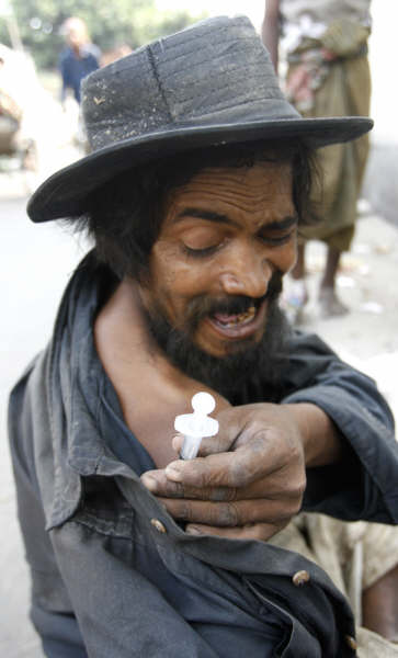 An injecting drug user on the streets of Dhaka, the Bangladeshi capital. Bangladesh's low prevalency rate for HIV is now under threat.