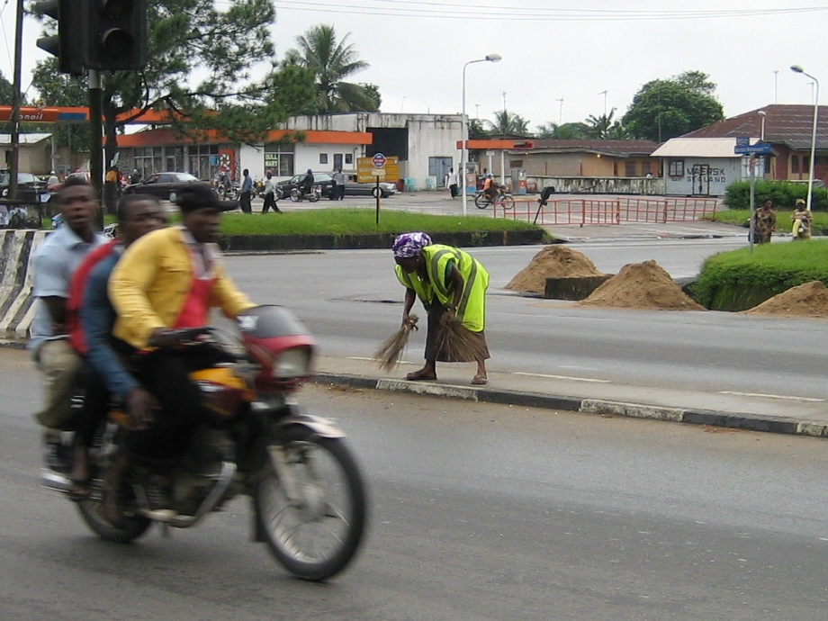 One of 823 women employed to sweep the streets of Calabar for three hours a day.