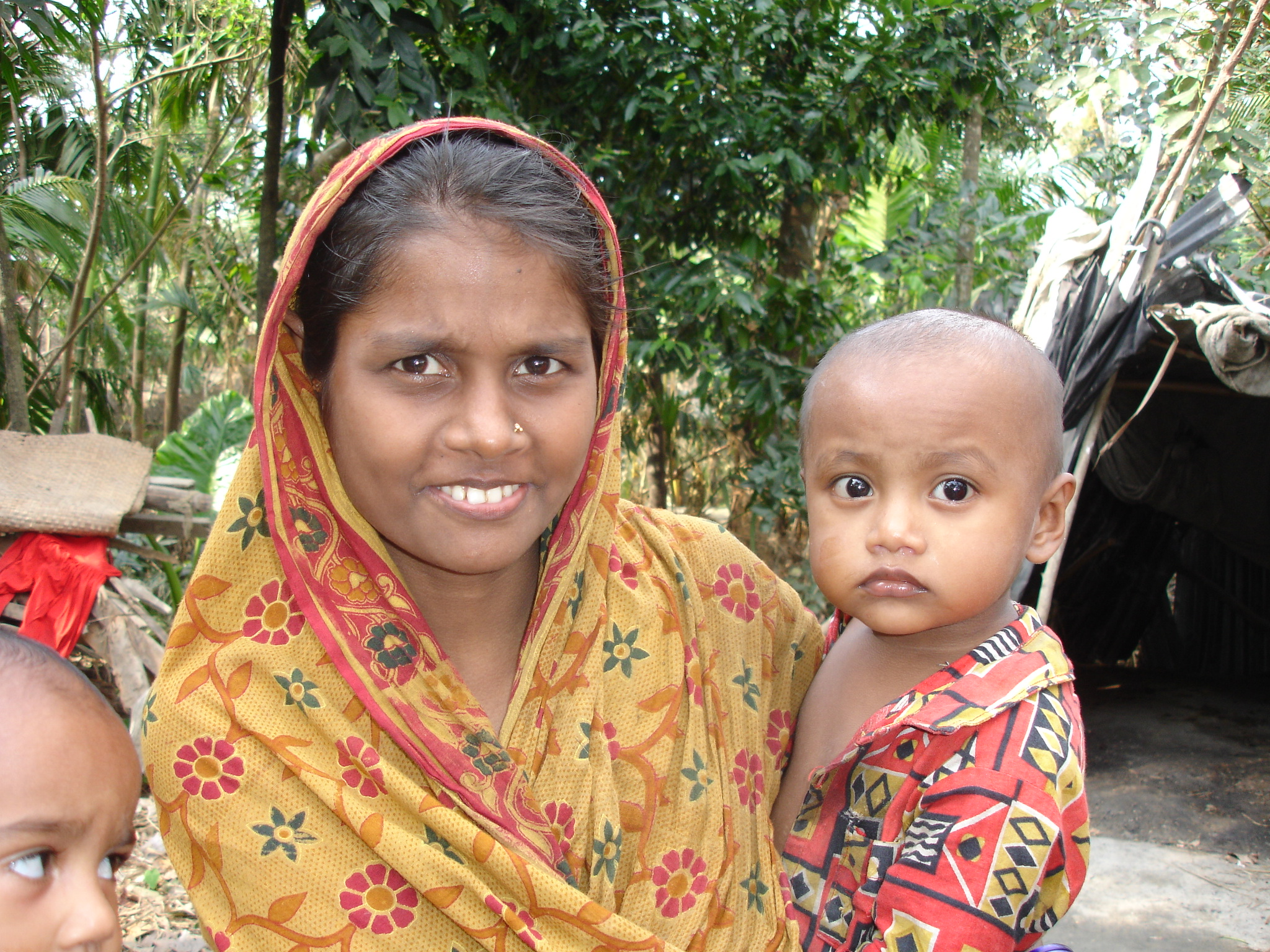 A mother and her child in cyclone-affected Patuakhali District, southern Bangladesh. Infants, young children and pregnant and lactating women are most vulnerable to malnutrition and micronutrient deficiencies because their nutritional requirements are gre