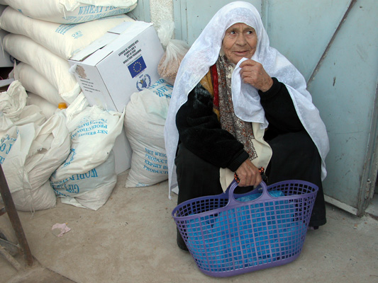 A Palestinian woman receives food aid from the World Food Programme in Gaza City.