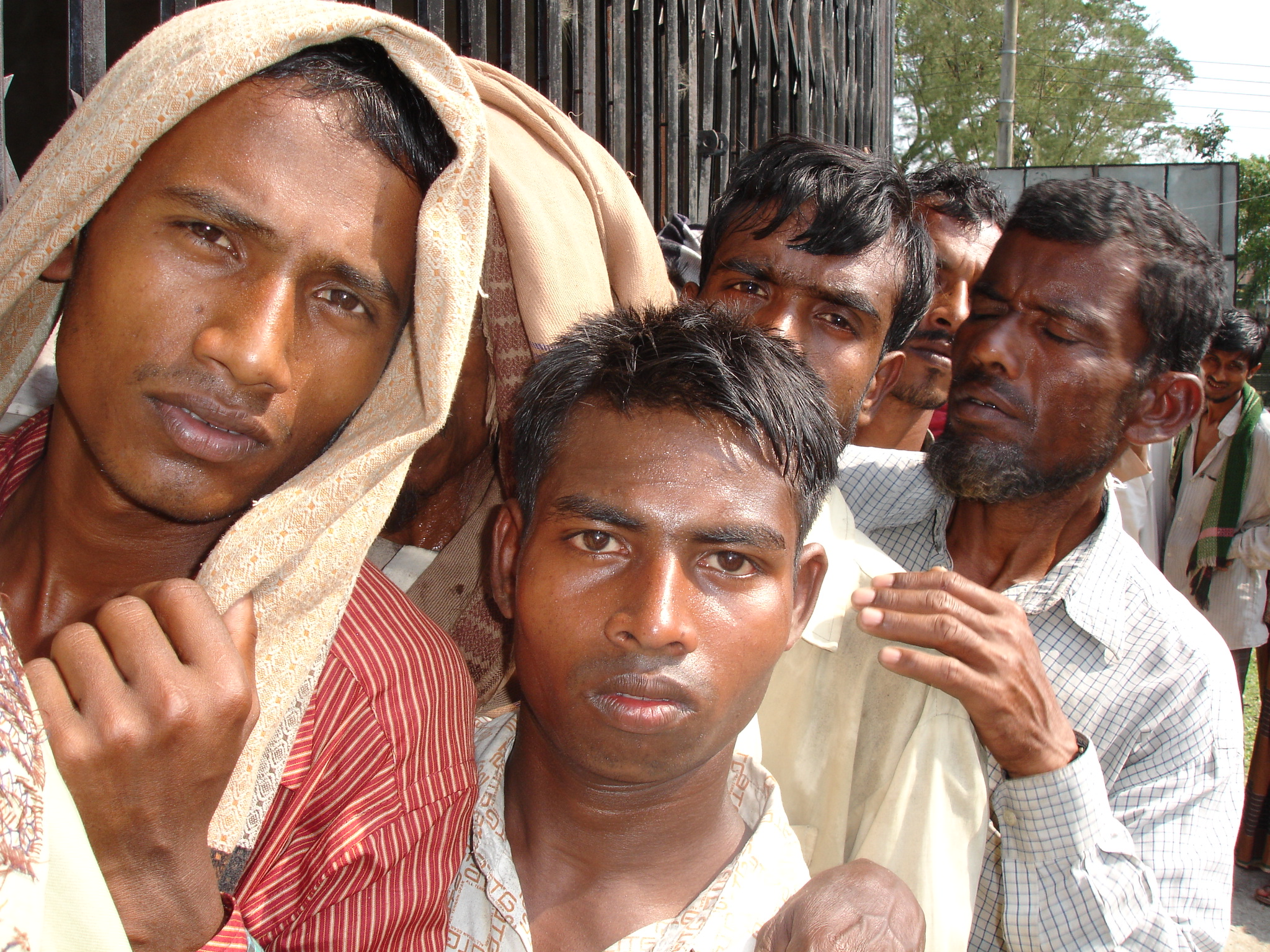 Men queue up for much needed government relief in Patuakhali District, southern Bangladesh, in the wake of Cyclone Sidr on 15 November. More than 3,000 people were killed when the category four storm struck the country's coastal belt.