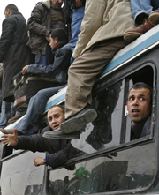 [Gaza] Palestinians wait  outside the main gate of the Rafah border crossing, as they attempt to get to Egypt, Gaza, 7 February 2007. Thousands  of Palestinians came to the border, in the hope  of getting across. Israel, citing security alerts, has kept t
