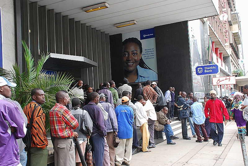 Zimbabweans queue for cash outside a Harare bank.