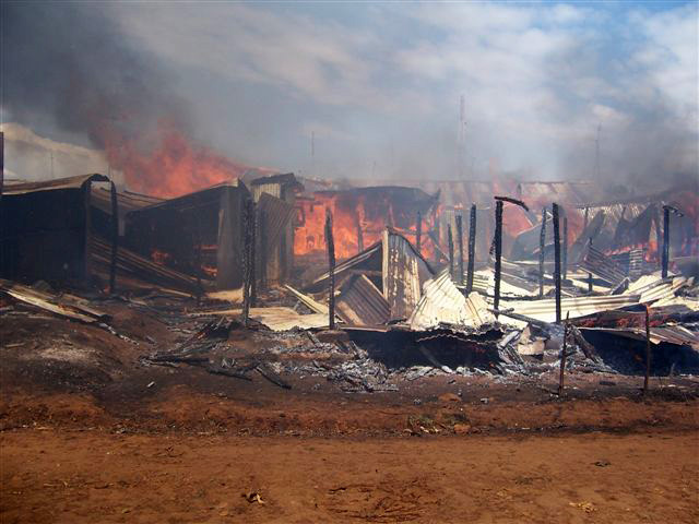 Fire guts down property that was allegedly set on fire by the rival political supporters during the on going post election violence in Kenya, Eldoret, Kenya. January 2008. Majority of people have been displaced following the post election violence that ha