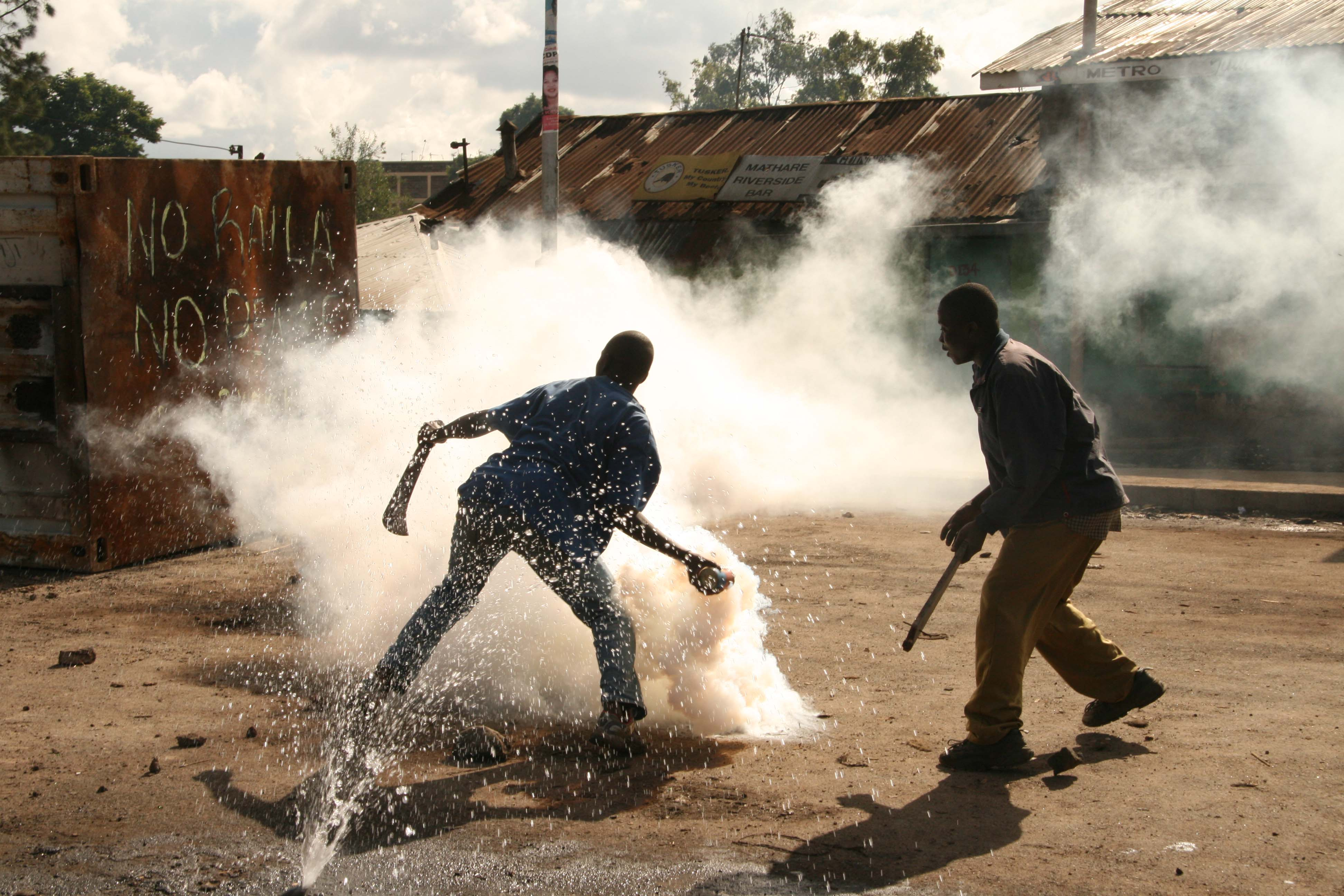 Demonstrators throw back tear gas to the police, Mathare slums, Nairobi, Kenya. 16 January 2008. This was the during the first day of the countrywide mass action that had been called by opposition leaders.
