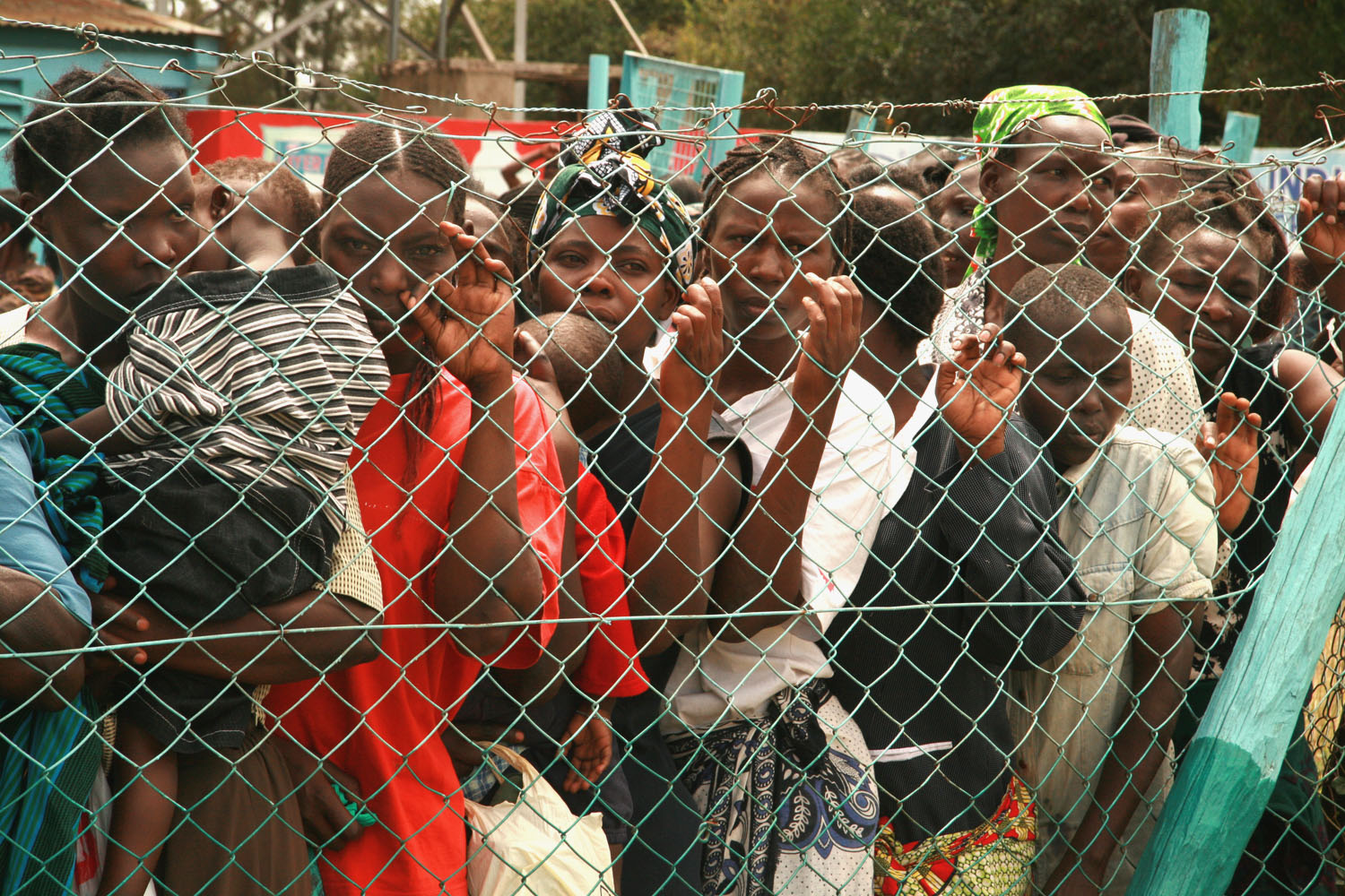 Women line up to receive relief food at the Nairobi show grounds, Kenya. January 2008. The effects of post-election violence in Kenya continue to reverberate throughout the country. An estimated 250,000 people have fled their homes.
