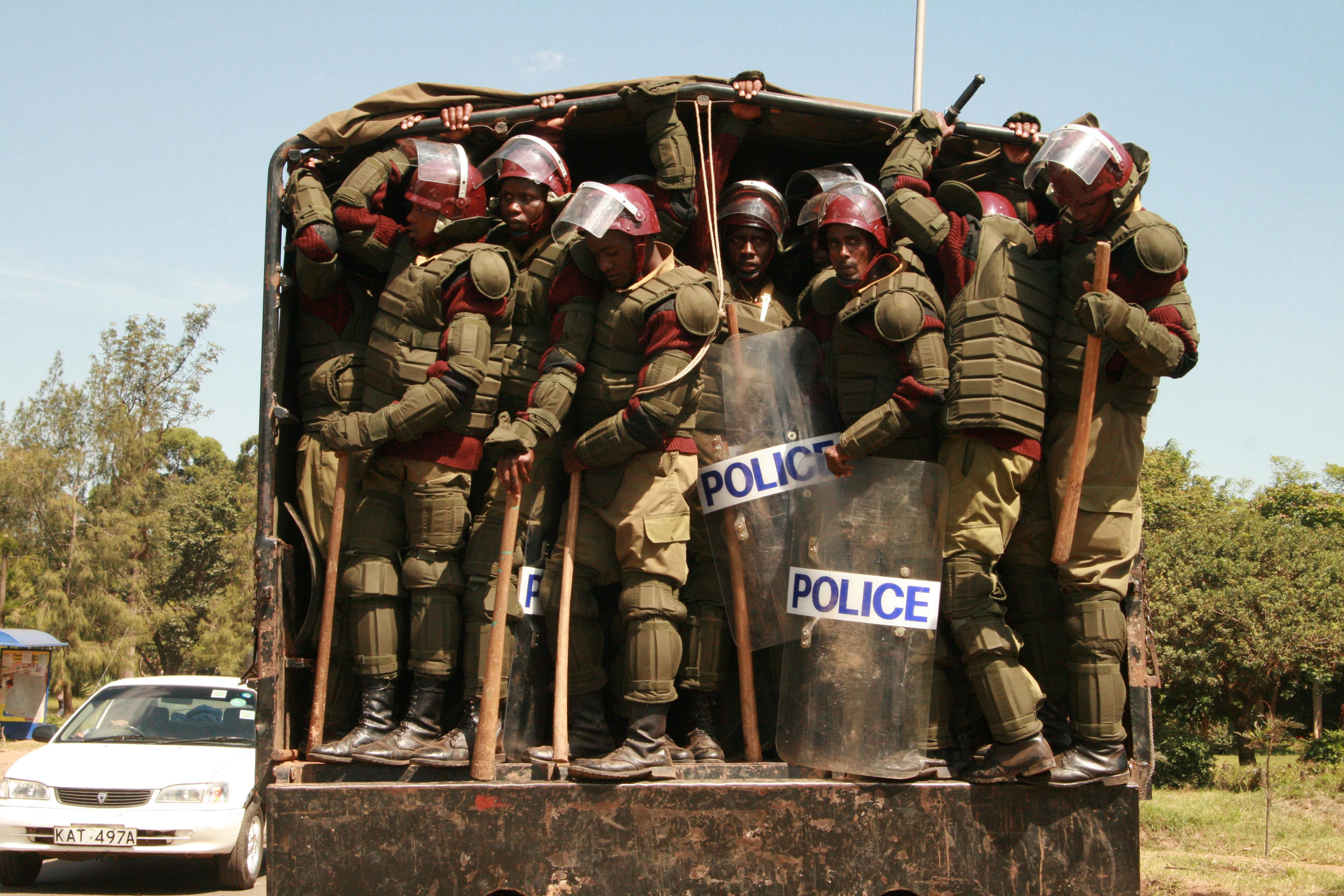 Anti-riot police brought in to control demonstrators during a funeral service for people killed in post-election violence in Ligi Ndogo, Nairobi, Kenya, January 2008.
