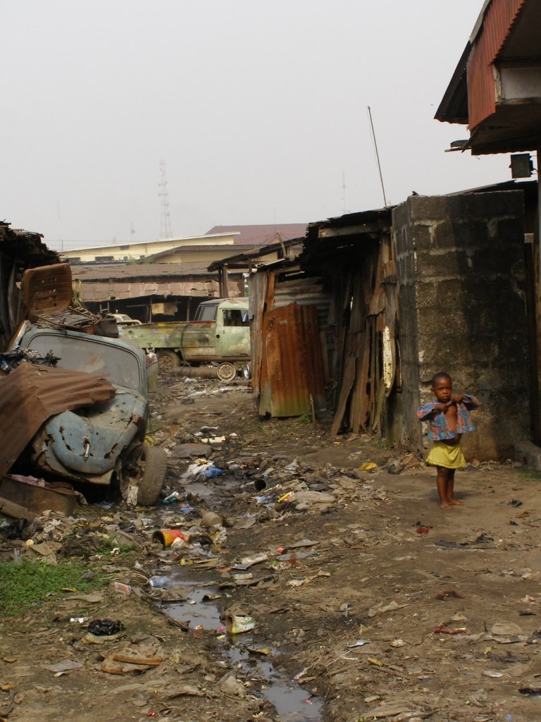 A child on the street in Diobu, one of the poorest regions of Port Harcourt. Despite the booming oil industry focused on the city, blue collar workers earn on average 20,000 naira (US$170) per month