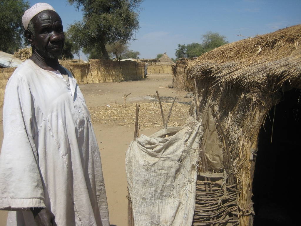 Mahamat Said stands outside his empty hut in the Habilé site for displaced people, outside the town of Koukou-Angarana in southeastern Chad. He and his family have moved back to their home village of Louboutigué, 20 km away.