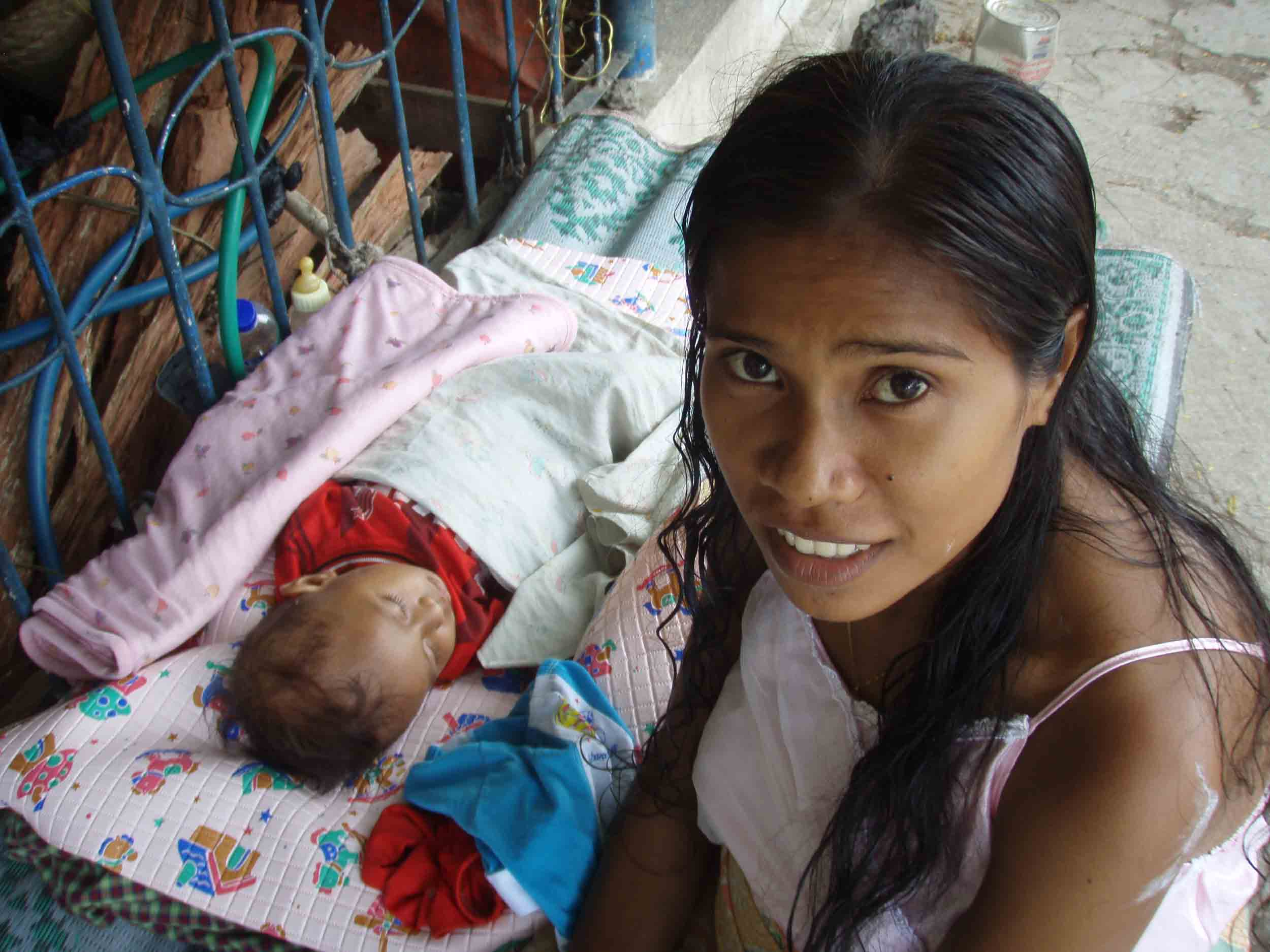 An IDP at Jardim camp in Dili. Her child was born at the camp.