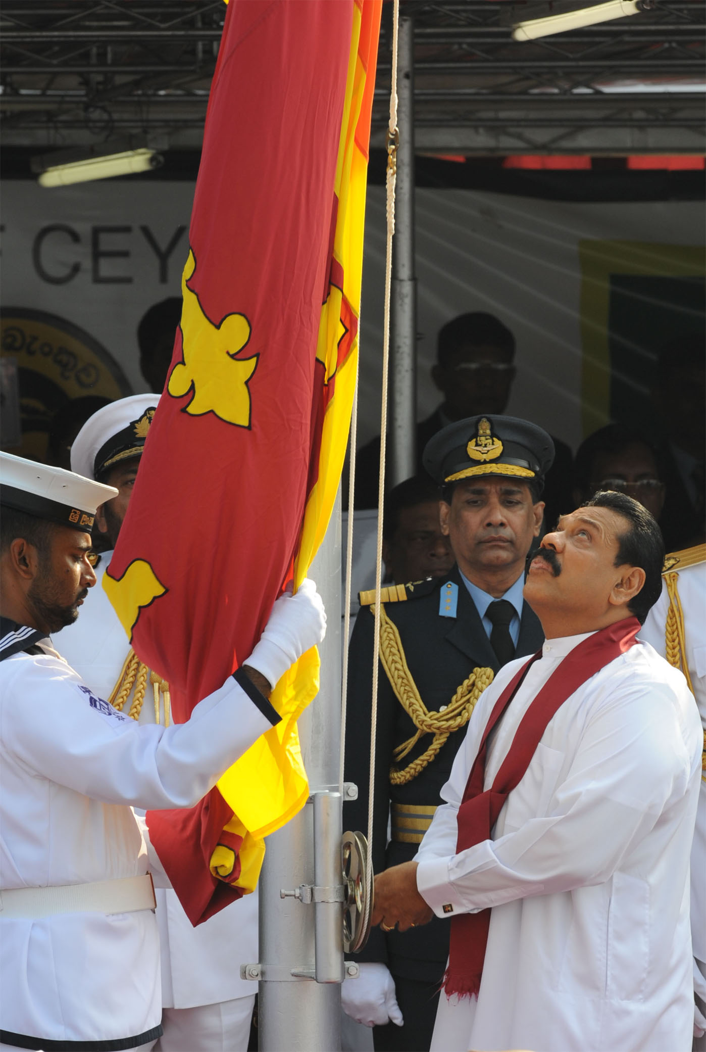 Sri Lankan President Mahinda Rajapakse hoists the national flag at a tightly-guarded Independence Day function in the capital Colombo. He has vowed to crush Tamil Tiger separatists by the end of the year.